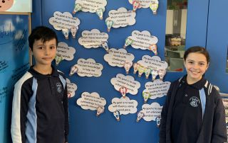 Our Lady of Mount Carmel Catholic Primary School Mt Pritchard Bonnyrigg - students at Learning goals wall
