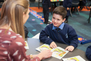 Our Lady of Mount Carmel Catholic Primary School Mt Pritchard Bonnyrigg - student reading a book with teacher