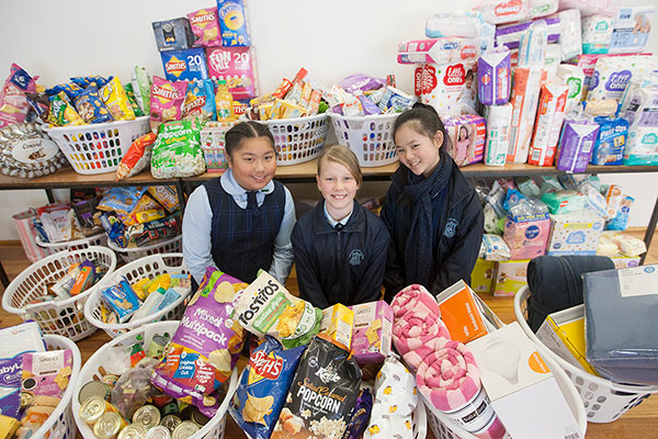 Our Lady of Mount Carmel Catholic Primary School Mt Pritchard Bonnyrigg - students standing next to food drive