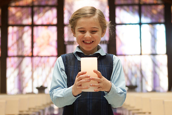 Our Lady of Mount Carmel Catholic Primary School Mt Pritchard Bonnyrigg - student holding a candle